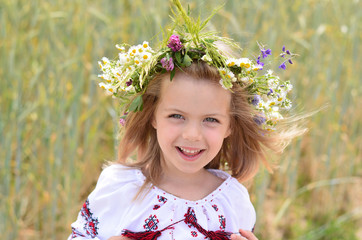 Portrait of amazing little girl in Ukrainian traditional shirt