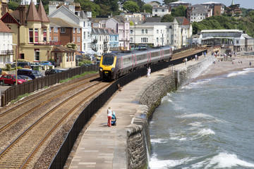 Cross country service passenger train at Dawlish Devon UK