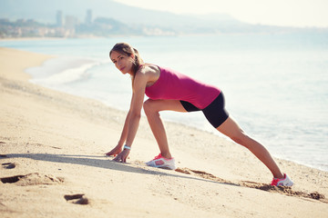workout on the beach before the running by athletic girl