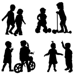 Couples of children silhouette