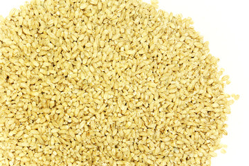 Pile of pearl barley on a white background