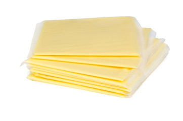 Square pieces of cheese in plastic packaging