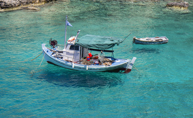 Fishing boat in the clear water of Peloponnese
