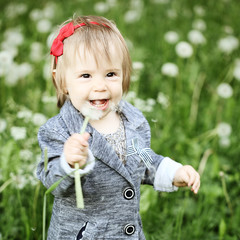 Carefree little girl laughing outdoors - fun!