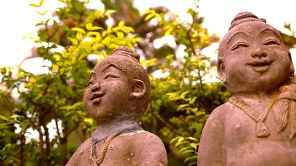 Smiling Buddha sculpture, Thailand. Video macro shift motion