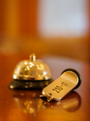 Hotel bell and key lying on the desk