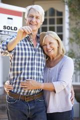 Senior couple moving house