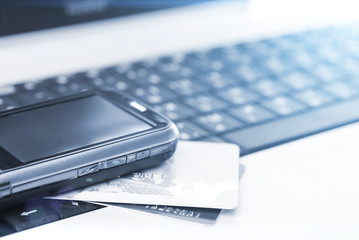Credit cards and mobile phone on the laptop