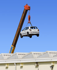 Car Hanging by the Arm of a Crane