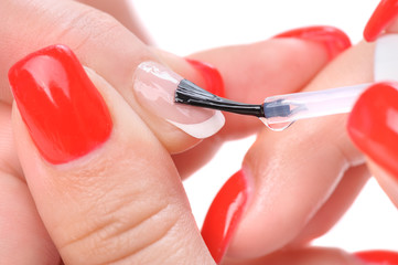 manicure, applying clear enamel