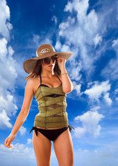 woman with straw hat and corset