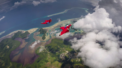 Wingsuit Flyers Enjoying The Palau Coastline
