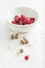 Fresh organic raspberries with hazelnuts