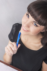 Nice Portrait of Brunette Woman with Notebook Thinking
