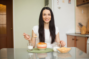brunette girl eating breakfast with milk