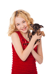 blonde little girl holding  puppy wearing red dress
