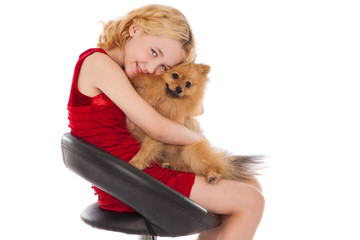 blonde girl holding  her dog wearing red dress