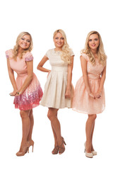 three beautiful girls in fashion dresses isolated
