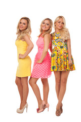three beautiful girls in fashion dresses