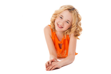 little smiling girl in orange clothes