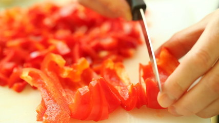 food. slicing with kitchen knife red sweet bell pepper vegetable