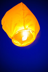The Chinese lantern flies up highly in the sky.