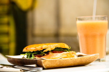 healthy and tasty breakfast sandwich and smoothie