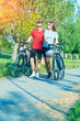 Caucasian Couple Walking With Bicycles in Nature Surroundings