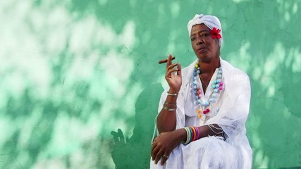 6of11 Portrait of old black cuban woman smoking cigar