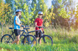Cycling Athlets Exercising with Bicycles in Nature Environment O