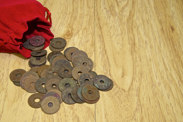 Old ancient coins of Thailand with red bag