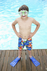 Boy by outdoor swimming pool
