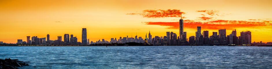 Panorama with Jersey City and New York at sunrise