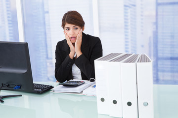 Worried Businesswoman At Desk