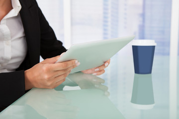 Businesswoman Using Tablet Computer At Desk