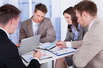 Business People Discussing At Table In Office