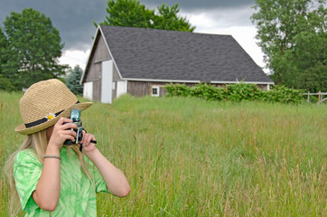 young girl with old-fashioned camera