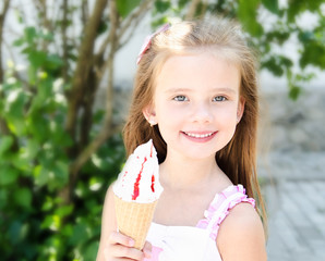 Adorable smiling little girl eating ice cream