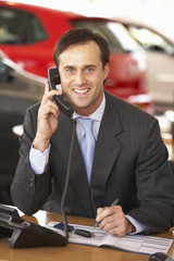 Man working in car showroom