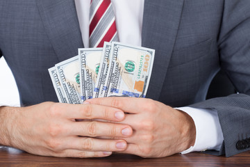 Businessman Holding Fanned Banknotes