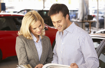 Man buying new car