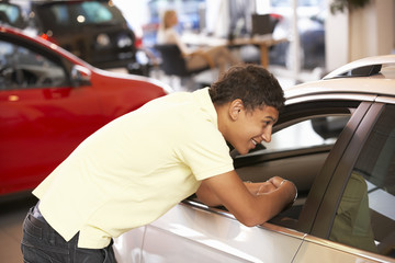Young man buying new car