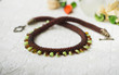 Brown necklace with beads in the form of droplets