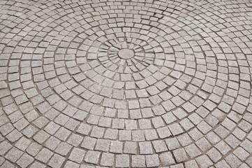 Pflastersteine in Kreisen angeordnet