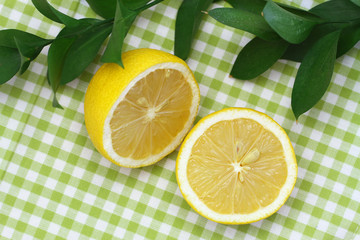 Lemon halves on green checkered cloth