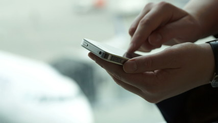 Close-up shot of female hands typing sms on smartphone