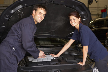 Female trainee mechanic at work