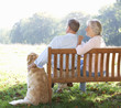 Senior couple outdoors with dog
