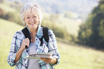 Senior woman on country walk