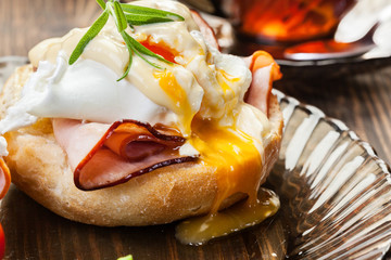 Eggs Benedict on toasted muffins with ham